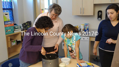 From left, student  Kyra, from Jefferson; Speech Therapist Elaine Tibbets; student Cassie, from Jefferson and Educational Technician Jocelyn Joyce work together to turn cupcakes into a multi-part lesson in Jefferson Village School's Pathways Educational Center. (Shlomit Auciello photo)