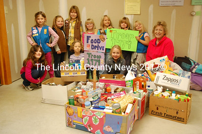 Girl Scout Troop 1474, from South Bristol, celebrates the success of its food drive. The girls especially thank Susan Goodwin for her generous donation. The Scouts will continue to accept donations at the South Bristol town office until Monday, Dec. 10, when they will deliver the food and other goods to the New Harbor Food Pantry. From left to right, Claire Thompson, Violet Bailey, Lexi Libby, Paige Olson, Allyson Poole (front), Madison Scott, Meghan Leeman, Gretchen Farrin (front), Sophie Thompson, Cassidy Leeman and troop leader Annette Farrin. (J.W. Oliver photo)
