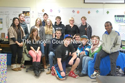 The 2012 Lincoln Academy Student Technology Team. Standing, from left to right: Ploy Intarawut, David Sieracki, Becca Hadik, John Braley, Kara Mullin, Dan Mayer, Maya Crosby and Luke Levesque. Seated, from left are: McKenzie Kinney, Noah Dawson, Wally Morris (kneeling), Nathan Osborne, Greg Anderson, Ethan Bartholomae, Morgan Perry and Kaleab Buchwalder.  (J.W. Oliver photo)