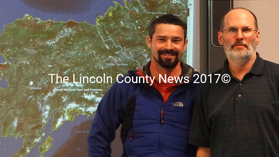Former Nobleboro Central School student Seth Campbell, left, stands with science teacher Ken Williams in front of a map of Alaska. Williams will join Campbell next spring on a scientific expedition into Denali National Park. (Shlomit Auciello photo)