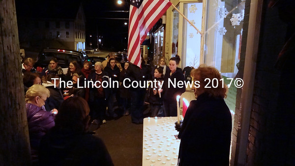 In downtown Waldoboro, close to two dozen people took time from their holiday weekend to remember the victimes of the Dec. 14 mass shooting at Sandy Hook Elementary School in Newtown, Conn. The candle lighting was initiated by Mom and Squawk Shop owner Tawsha Hisler and her mother, Karen Hutchins. (Shlomit Auciello photo)