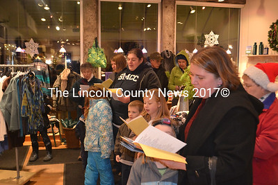"""Carolers sing """"We Wish You A Merry Christmas"""" inside In the Clover in Wiscasset. (D. Lobkowicz photo)"""