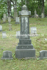The Deacon Frederick and Lydia Hatch family monument dominates the front left section of the Hatch Burying Grounds. The small stones on either side memorialize Frederick and Lydia. An inscription on the left side of the monument lists young daughters Fannie and Carrie.