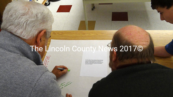 Members of the Regional School Unit 40 Board of Directors respond to a statement about standards-based education, in an exercise at the board's Dec. 20 meeting. (Shlomit Auciello photo)