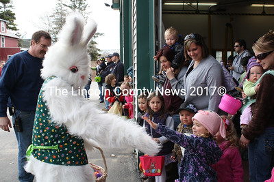 The most popular guy at the Easter Egg Hunt is the Easter Bunny, giving a high-five to a fan.