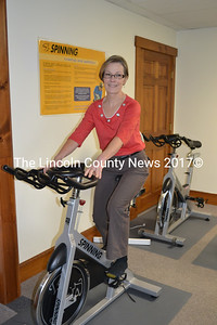Displaying perfect spinning form, (though not in workout garb) ComeFit Zone co-owner Judy Woodward is a spin master. (Kim Fletcher photo)