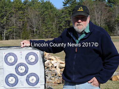 David Abbott with a target used in indoor archery competition. (Paula Roberts photo)