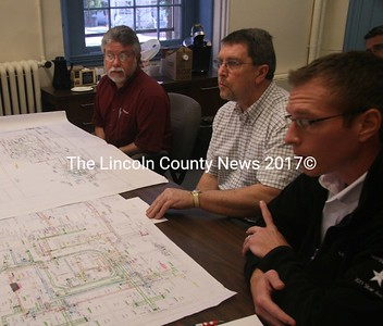 Siemens Inc., representative Paul Bock, Lincoln County Maintenance Supervisor Jim Hopler and Siemens representative Tom Seekins (left to right) present a heating/cooling plan for the old Lincoln County Jail jail to the County Commissioners April 3. (Kim Fletcher photo)