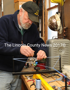 David Abbott demonstrates how he makes his own bow strings in his Alna shop. (Paula Roberts photo)