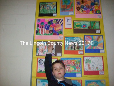 Cooper Swartzentruber points to his painting at the top center of the panel for first grade artists. (Cina McLean photo)