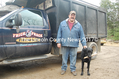 Frick & Frack Firewood and Delivery owner Paul Blomquist with company mascot Hunter. (J.W. Oliver photo)