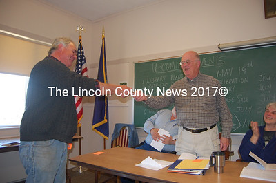 Former Bremen Selectman Tom Kostenbader hands his keys to his successor, John Marsh, at the Bremen annual town meeting March 31. (J.W. Oliver photo)