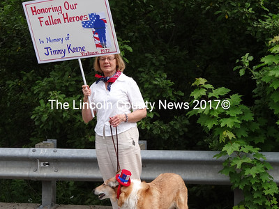 Jeannete Wheeler carrys a sign honoring an old friend who died in the Vietnam War. She said Jimmy Keene died when he stepped on a land mine in 1972. (Shlomit Auciello photo)