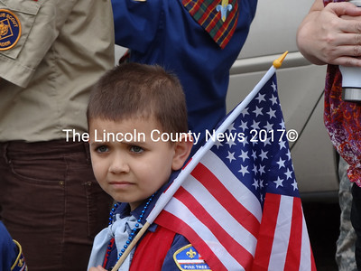 Cub scout Gabriel Laweryson, 9, of Pack 216 in Jefferson watches the May 28 Memorial Day ceremony in Waldoboro. (Shlomit Auciello photo)