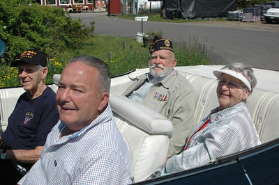 Lead car driver Veterans Ron Toussaint and Tot Morton escorted Captain Joe Gray (ret.) Grand Marshal of the Memorial Day Parade and his wife Carolyn.