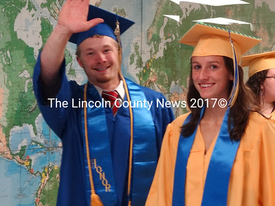Seniors Mark Tolman of Waldoboro and Mallory Conary of Warren join classmates as they walk the halls of Medomak Valley High School just prior to the graduation ceremony that will mark their entry into the larger world. (Shlomit Auciello photo)
