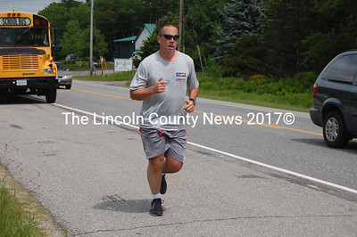 Lincoln County Sheriff's Office Lt. Rand Maker runs south on Rt. 1 in Newcastle. Maker said he would run from the Damariscotta-Newcastle townline to the Newcastle-Edgecomb townline, a distance of approximately 6.5 miles. (J.W. Oliver photo)