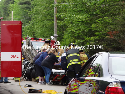 Emergency Medical Service, police and fire from Waldoboro scramble to assist victims of a head-on collision on Rt. 1 June 8. (S. Auciello photo)