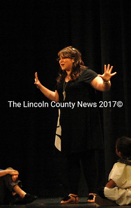 "Cayleigh Hearth as the Narrator tells the story of  ""Joseph and the Amazing Technicolor Dreamcoat."""