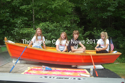 South Bristol School's class of 2013 aboard the skiff they'll raffle to pay for their class trip to Washington, D.C. The class of 2012 built the skiff. From left to right, Jordan Farrin, Jillian Page, Tyler Giles and Julianna Preston. (J.W. Oliver photo)
