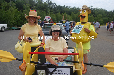 Photographed are (from left)  Maureen Kronenberger, Judy Groves and, in one of the parade's most creative costumes, Tom Kronenberger prepare to ride and walk for the Rubber Ducky River Race, a benefit for the Pemaquid Watershed Association. (J.W. Oliver photo)