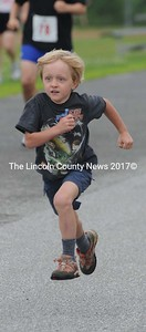 This little guy sprints to the finish in the fun run.