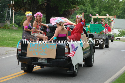 """The """"Bath Salts"""" float features an inflatable male doll in a pink bathrobe on the roof of the cab and a sign that claims """"Edna and her bridge group started using in 1937."""" (J.W. Oliver photo)"""