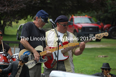 Stevo Bailey plays guitar and Jim Dorian bass guitar for the Paulbearers on the DamBluesFest float. The 2012 festival takes place Aug. 4 at the Darrows Barn in Damariscotta. (J.W. Oliver photo)