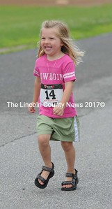 This young gal finishes the fun run with a smile.