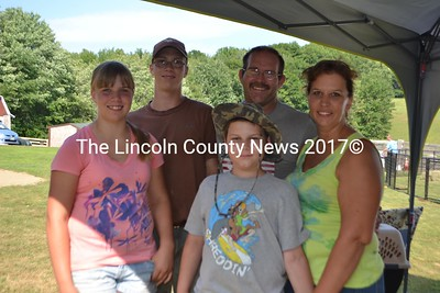 The Eugley family (left to right) Meghann (12), Rodger, Jr.  (14), Isaiah (10), Rodger, and Michelle. The family runs Rooster Ridge Farm in Waldoboro,where they raise pigs, ducks, chickens, bunnies, and sell Poulin grain. (H. Perkins photo)