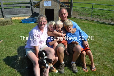 Derilyn Nelson and Shawn Gregory of Stones Edge Farm in Newcastle with their three children Dakota (7), Maddox (1), and Chase (9). They breed Bernese Mountain dogs (two seen here) along with three types of goats, and miniature horses. (H. Perkins photo)