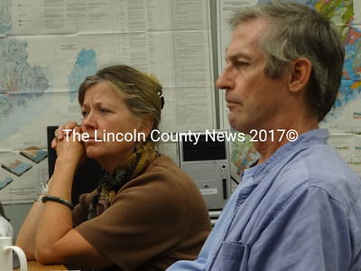 Margaret and George Fergusson, of Whitefield, listen to DEP Presiding Officer and Policy Director Heather Parent describe procedures related to an upcoming hearing on a lake level petition filed by George Fergusson on behalf of landowners on the shore of Clary Lake. (Shlomit Auciello photo)