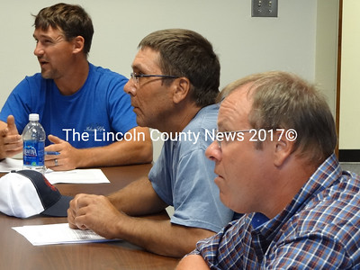 At the July 18 meeting of the Lobster Advisory Council, lobstermen Jeff Putnam, of Chebeague Island; John Drouin, of Cutler and Andrew Hawke, of Boothbay Harbor engage in a discussion about handling abrupt and unexpected changes in lobster supply. (Shlomit Auciello photo)