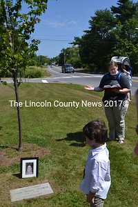 Wiscasset commemorated a stone and elm tree in honor of the late Woody Freeman, who died four years ago. Rev. Heather Blais reads the blessing while her son Logan, 4, looks on.  (H. Perkins photo)