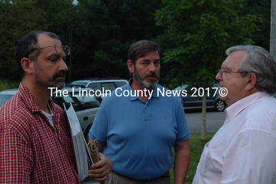 Robert Smith, Paul Kelley and attorney Anthony Buxton confer during a break in the five-and-one-half hour DEP hearing on the water level at Clary Lake. (S. Auciello photo)