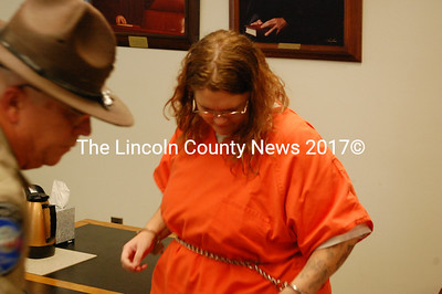 Arline Lawless prepares to exit the courtroom after a brief initial appearance Aug. 17. (J.W. Oliver photo)