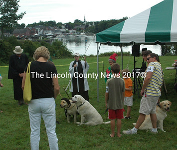 """""""Blessing of the Dogs"""" by The Rev. Lu-Anne Conner from St. Andrew's Episcopal Church in Newcastle.  (E. Busby photo)"""