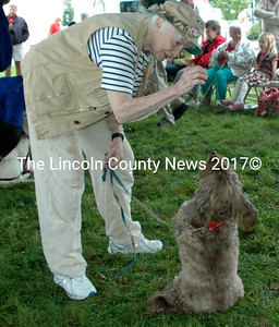 Lincoln County Animal Shelter Board member Kelly Patton Brook with her dog Jake, an alumnus of Lincoln County Animal Shelter, practice for the Best Trick competition.  (E. Busby photo)