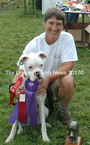 """Best in Show was awarded to Flour, a Boxer shown and owned by Cindy Blust of Nobleboro.  Flour also won awards in the Best Trick category, as a """"Look-Alike"""" and took first in the """"Likes the Judges"""" category.  This crowd favorite will retain the title and statuette until next year.  (E. Busby photo)"""