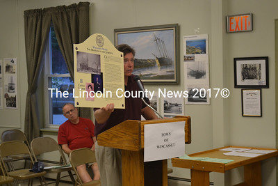 Ed Kavanaugh shows the Wiscasset Board of Selectmen a mock-up of the informative signs the Wiscasset Museums in the Streets project plans to install in the downtown area. (S. Olin photo)