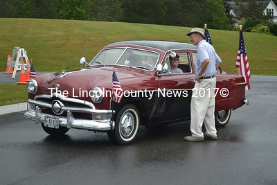 Jefferson Day car show coordinator John Day greets Emmons Martin who rolled in from North Waldoboro in his 1950 Ford Custom. (Sherwood Olin photo)