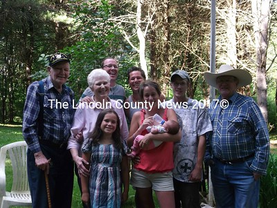Five generations of the O'Brien family gather to celebrate the June 26 birth of Aubrey Anne Brewer  at her grandfather's camp on Duckpuddle Pond. In front is Kaia O'Brien, age 9. Behind, from left, are her great-great grandfather George Dreves. Great grandmother Sandra O'Brien and mother Briana Carroll holding Aubrey Anne. In the back row are Desmond O'Brien, grandfather James O'Brien, father Nathan Brewer and great grandfather Robert O'Brien. (courtesy Christine Tupper)