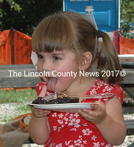 Kylea-Rae Mayes, 3, from New Harbor took a break from dancing with a nice slab of homemade blueberry pie. (E. Busby photo)