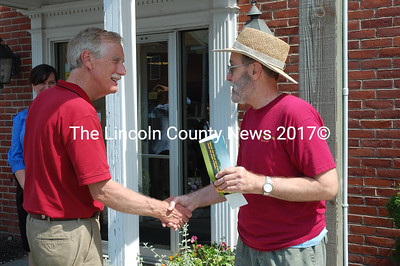 A supporter greets former Gov. Angus King outside Damariscotta Bank & Trust. (J.W. Oliver photo)