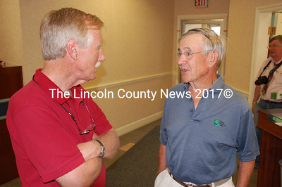 King chats with Damariscotta resident Victor Macomber inside Damariscotta Bank & Trust. (J.W. Oliver photo)