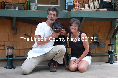 Miss Ashley's Sub Shack owners Randy Hopper and Kandi Ellis with their Rottweiler puppy, Horatio. The sub shack is back at is original location after a short move to the village. (J.W. Oliver photo)