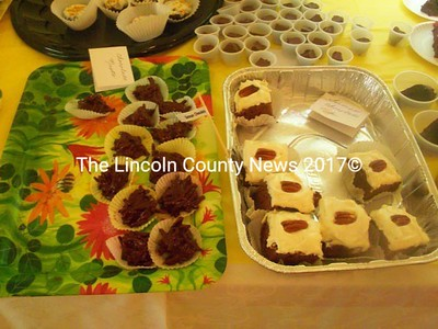 Rum balls, chocolate nests, and chocolate cake were among the dozens of desserts one could choose from at the Bremen's Chocolate Sunday Aug. 5. (H. Perkins photo)