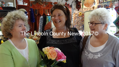 Patrons at  First Class Florals, Sept. 5, received free bouguets of roses as part of a national philanthropic event. Lynne Dodge was on hand to help store owner Monica Yeakel. Shown here, from left, are Dodge, Yeakel and customer Debbie Pooley of Edgecomb. (Shlomit Auciello photo)