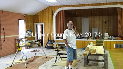 Upstairs and the former Nobleboro Grange #369, Richard Hatch is replacing windows and removing paneling, a dropped ceiling and sheetrock that cover the original finished surfaces. Hatch said he hopes to restore the building to its former state. (Shlomit Auciello photo)