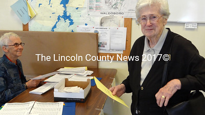 Waldoboro citizen Martha Boggs was one of the first to vote in a special town meeting referendum, Sept. 11., Looking on is Election Clerk Carol Blodgett.  Boggs celebrated her 96th birthday Sept. 12. (Shlomit Auciello photo)